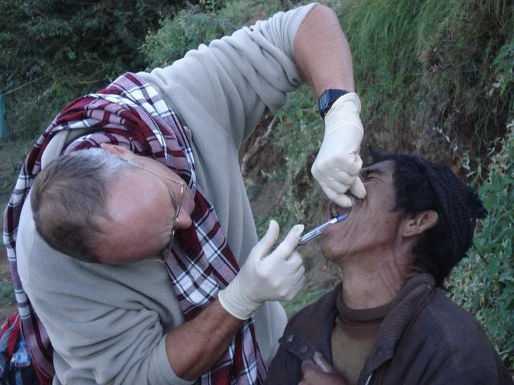 Volunteer dentist operating on the trail.
