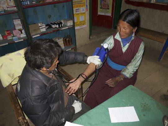 Mingyur treating a patient.