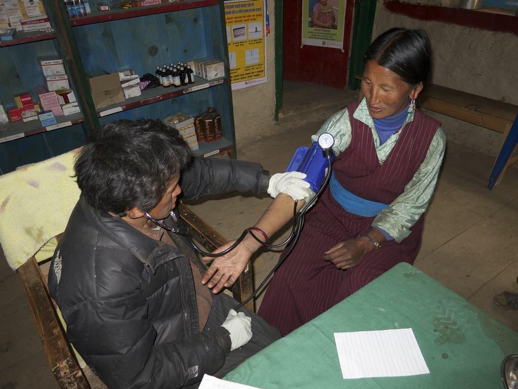 Mingyur treating a patient.