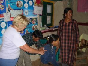 Volunteer nurse 'Janet' training and mentoring.