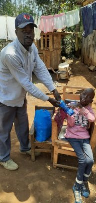 DCC Physio gives Emmanuel a facemask and handwash