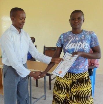 Maureeen receives her student certificate