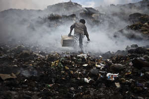 Boy in Garbage Dump