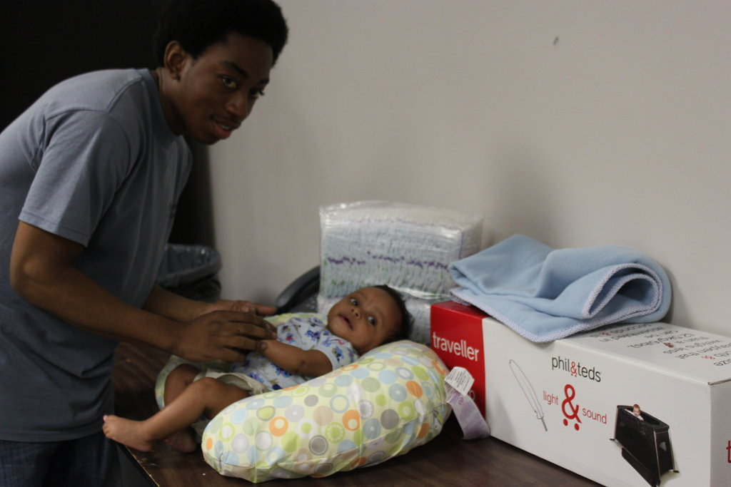 Father and Baby with More Baby Buggy Gifts