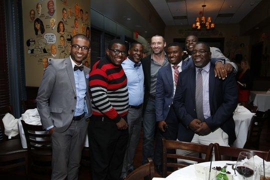 Fatherhood program directors + dads w/Hugh Jackman