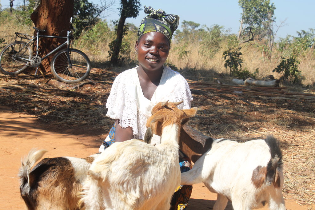 Jane Mwaba is very happy receiving her goats