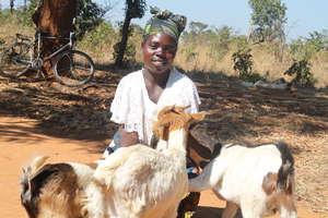 Jane Mwaba is very happy receiving her goats