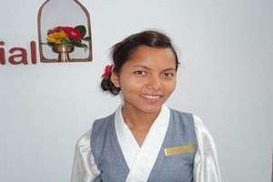 Manisha at the desk of the Summit Hotel