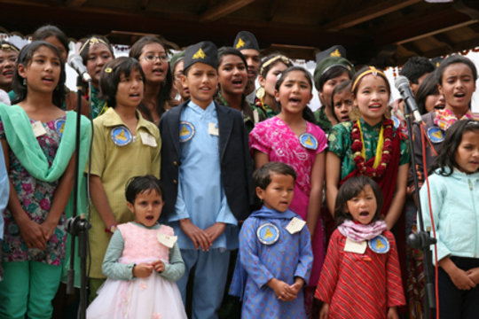 Children sing a welcome song at the opening