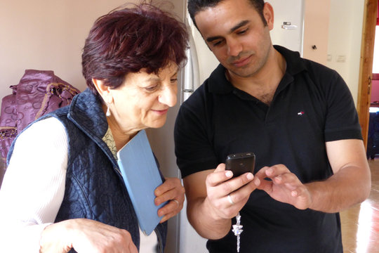Sadiq showing Nadia a picture of his Fiancee