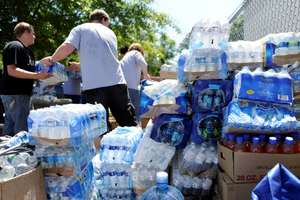 Volunteers unload water in Tuscaloosa, Alabama