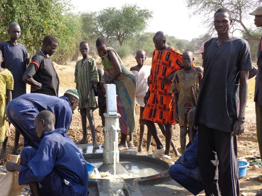 Putting the finishing touches on a well.