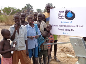 Happy children with new well in village of Aguor