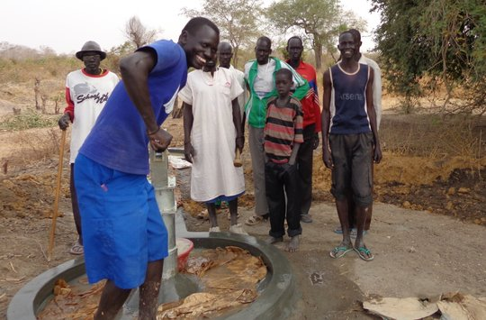 Pumping water from new well in South Sudan