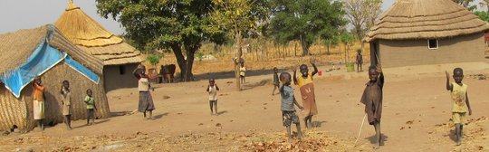 Villagers waving to WFSS team