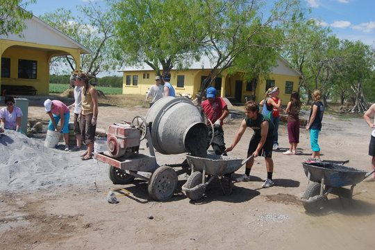College students mixing concrete