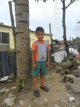 Boy eagerly awaiting a child sponsor
