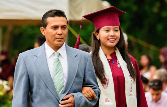 Jacqueline with her father on graduation day.