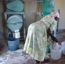 Martha Njoki at the mill grinding her cassava
