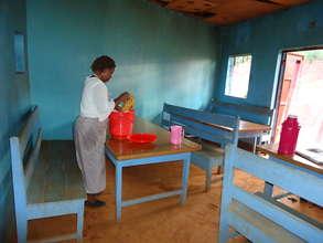 Mrs. Wanjiku in her restaurant
