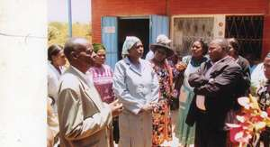 Community members gathering for visit