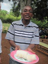 Michael holding prepared cassava