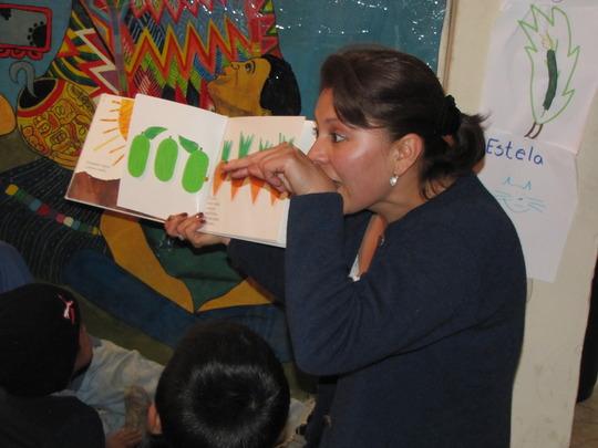 Alba reading to all her children.