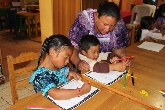 Mom helping her kids to get started.