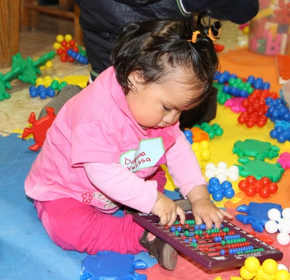Handling shapes facilitates letter recognition