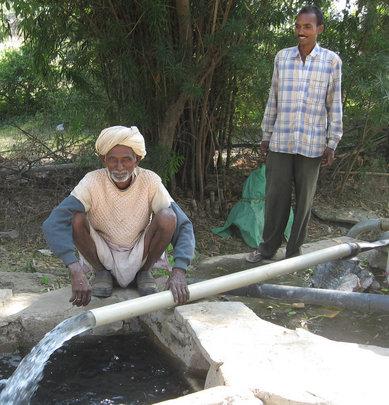 Deepak (left) Demonstrating The Well At Kundai