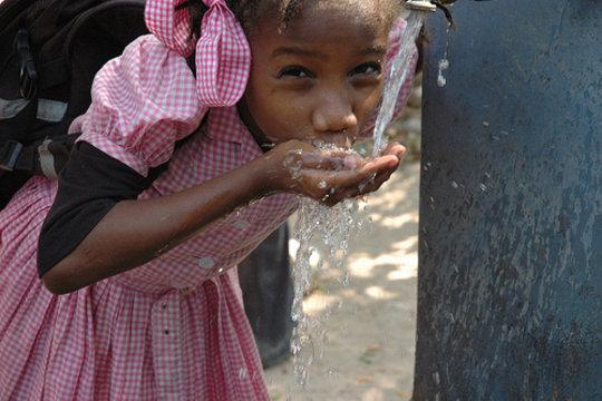 School girl drinking clean water
