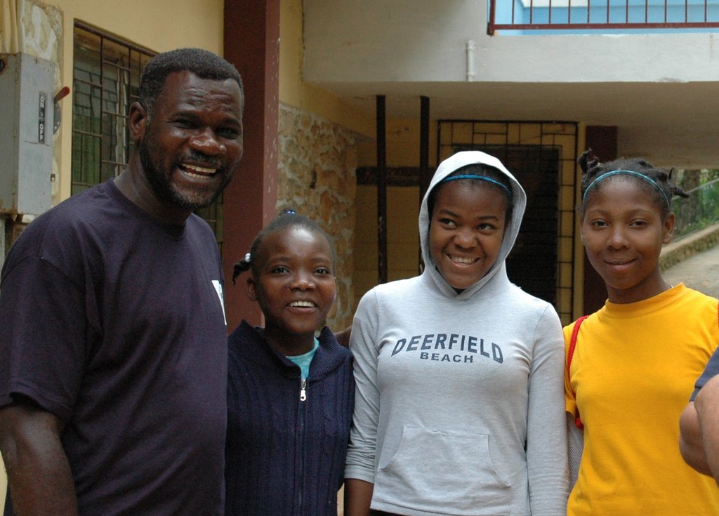Rochelle and her sisters with our country director