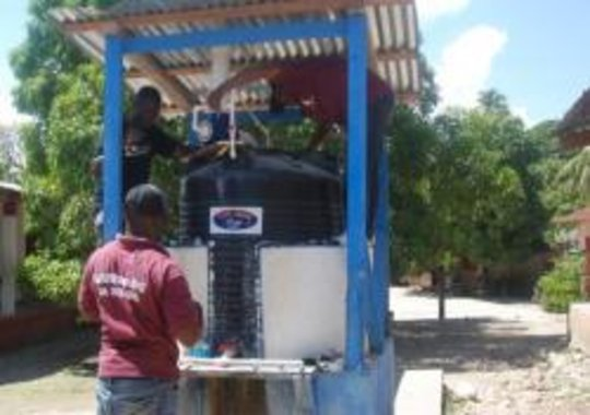The new chlorinator, water tank, and water pump at