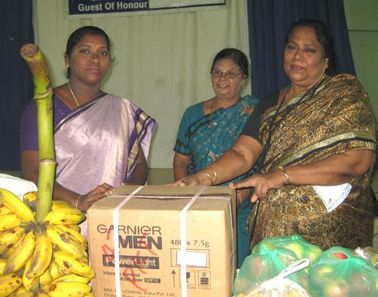 staff of YWCA donating fruits and provision toHOME