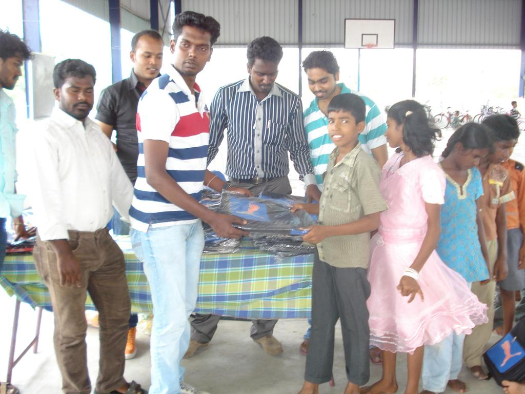 student from TNC College donating bags to children