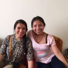 Rosa (left) and Gloria in their apartment in Lima.
