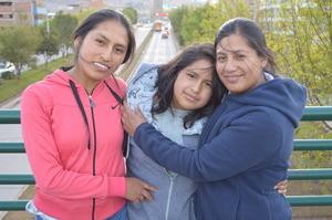 Karen with Maribel (left) and Eli (right)