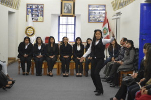 PH Scholar Elba Luz recites a poem at the ceremony