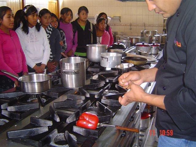 Peruvian Promise girls watch chefs at work