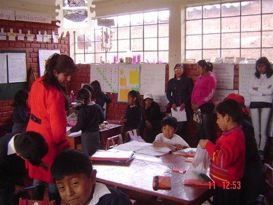 The girls observe a teacher in her classroom