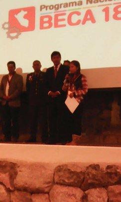 Gloria receives her award on stage in Cusco, Peru.