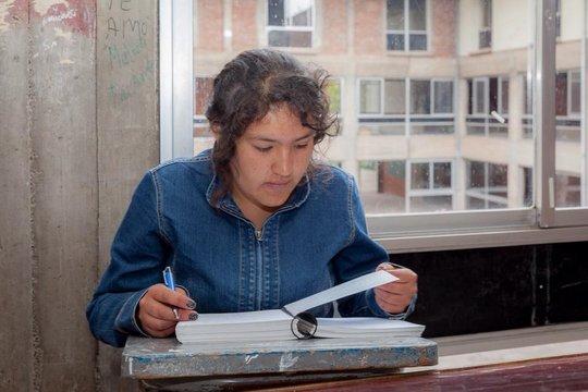 Maria working on math homework.