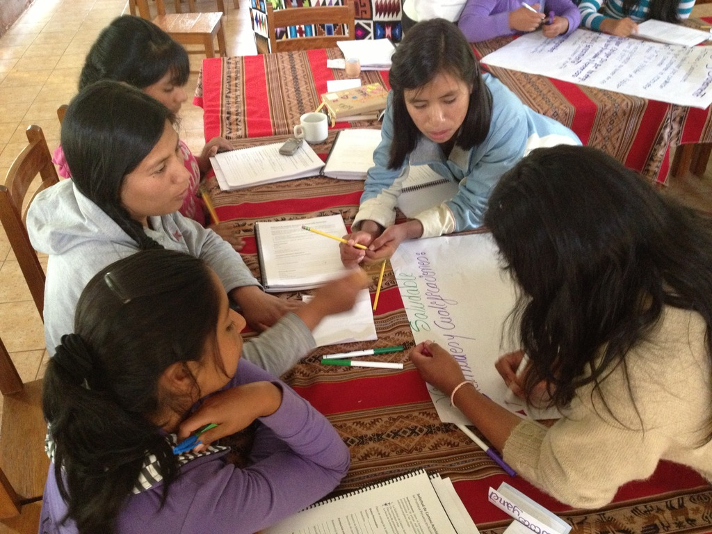 A group of girls plan their community project.