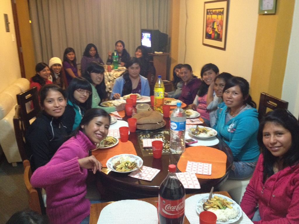 Girls in Peruvian Promise gather for dinner.