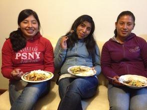 Lucero, Ana, and Elizabeth share dinner together.