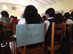 Peruvian Promise scholars listen to a speaker