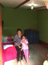Epi proudly poses in her newly painted bedroom!