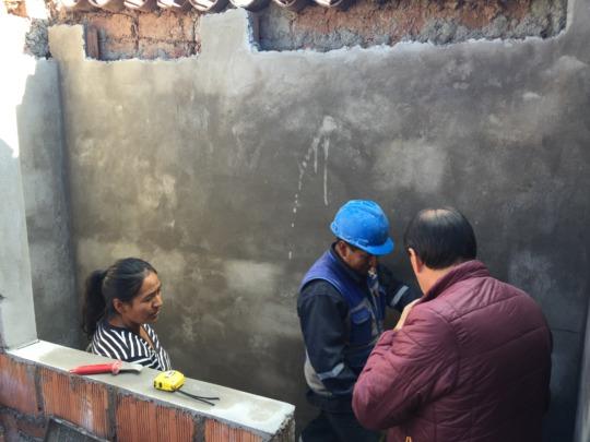 Epi checks on the progress of the new bathroom