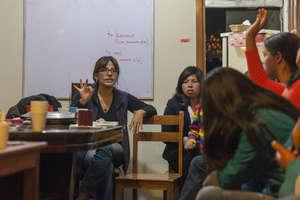 Jeannette Gonzalez, leads a group discussion.
