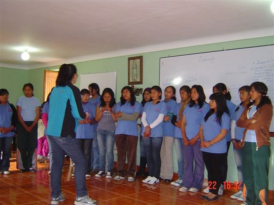 PP girls take part in an activity at a meeting.